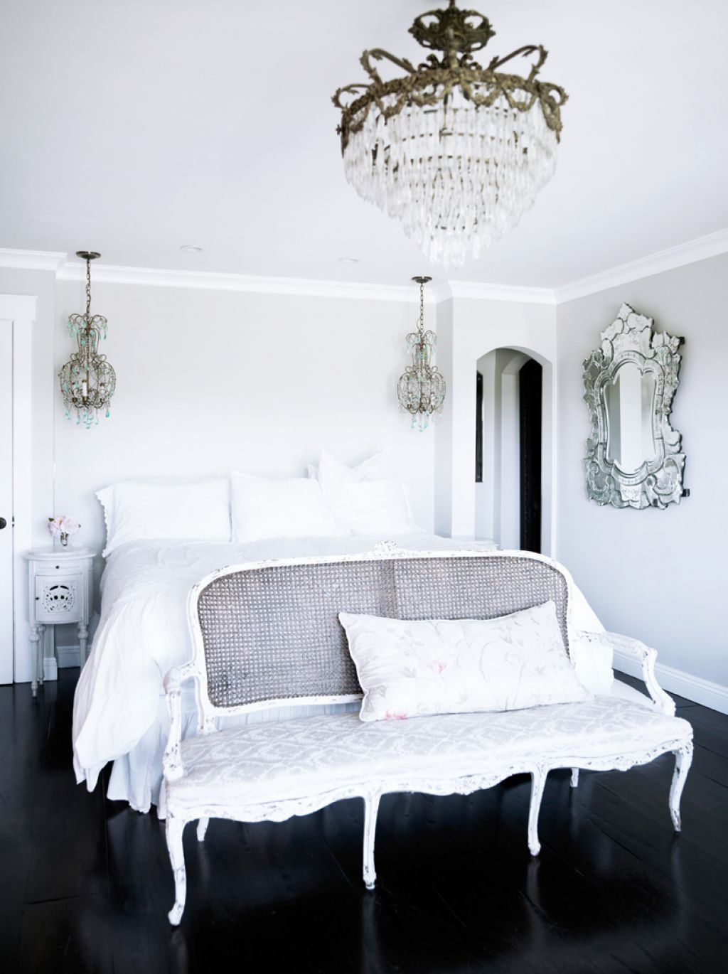 bedroom-with-crystal-chandeliers-and-venetian-mirror