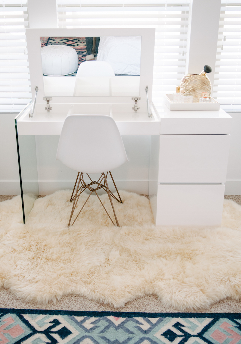 Minimal-white-vanity-with-pull-open-mirror