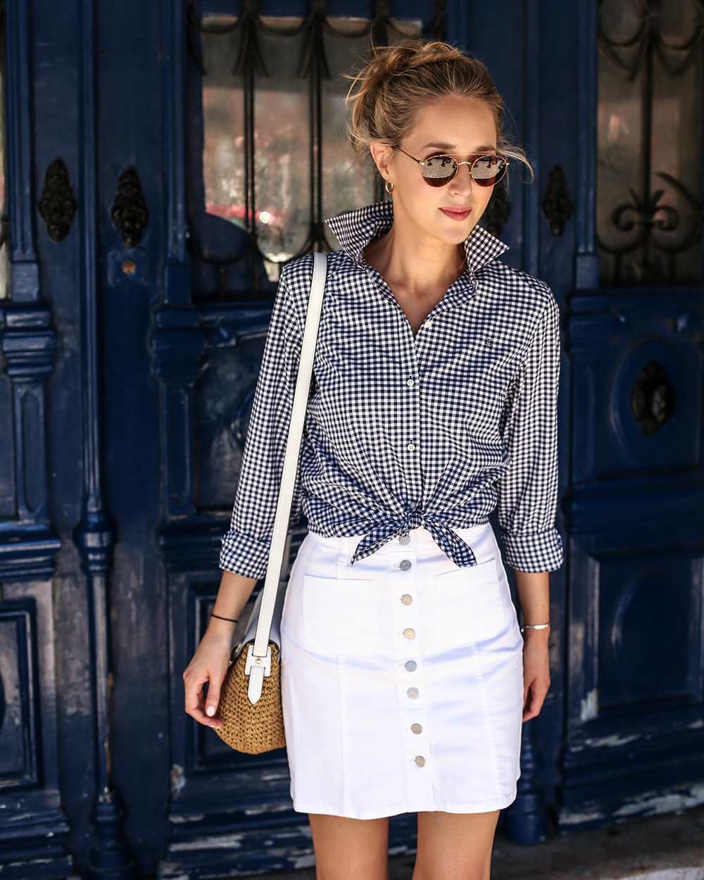 navy-white-gingham-shirt-tied-front-white-denim-button-front-mini-skirt-straw-white-leather-shoulder-cross-body-bag-fashion-style-travel-blog-26-680x850@2x