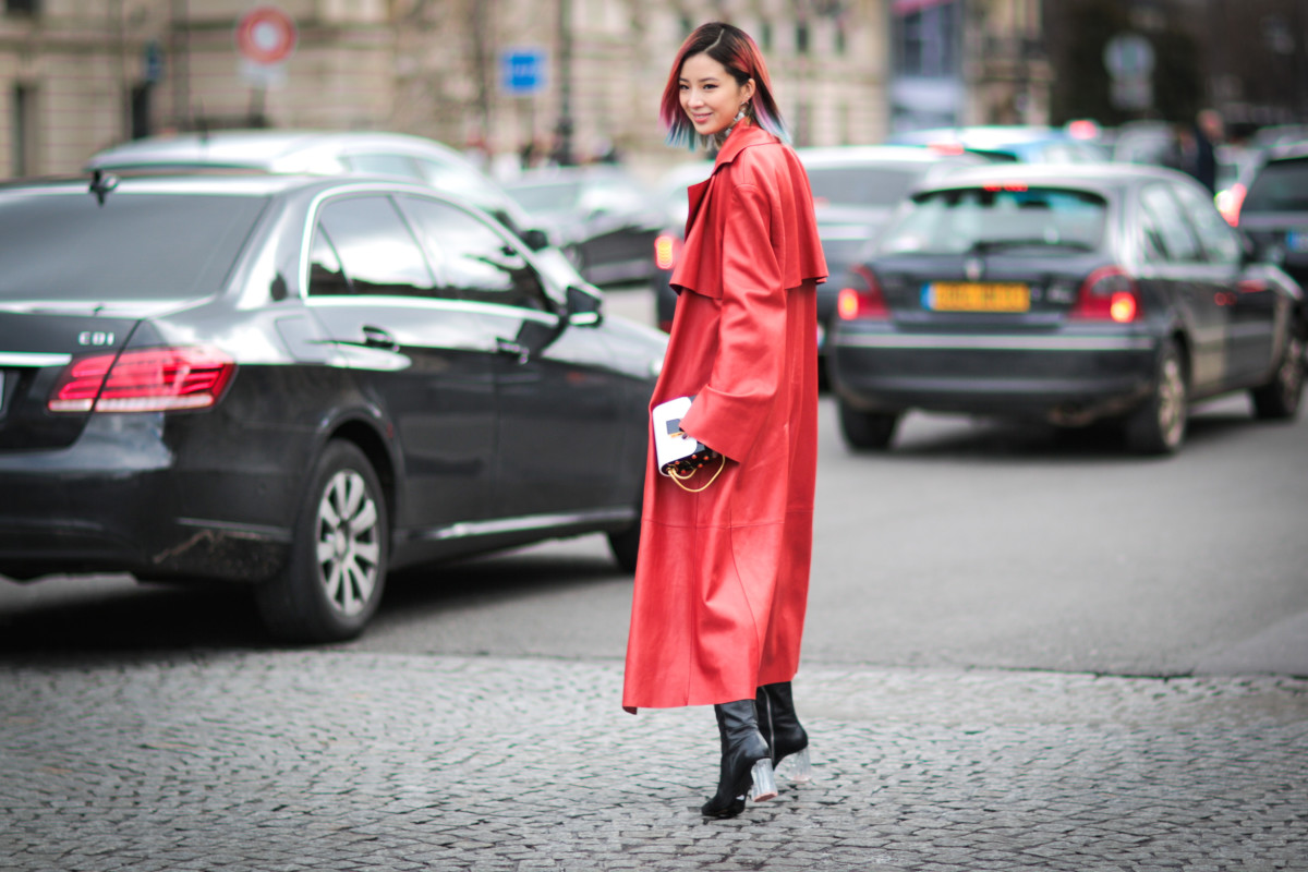 PARIS, FRANCE - MARCH 05: Irene Kim (Ireneisgood) is wearing an Acne Studios red coat and a Jimmy Choo bag, after the Mugler show, during Paris Fashion Week, Womenswear Fall Winter 2016/2017 on March 5, 2016 in Paris, France. (Photo by Edward Berthelot/Getty Images)