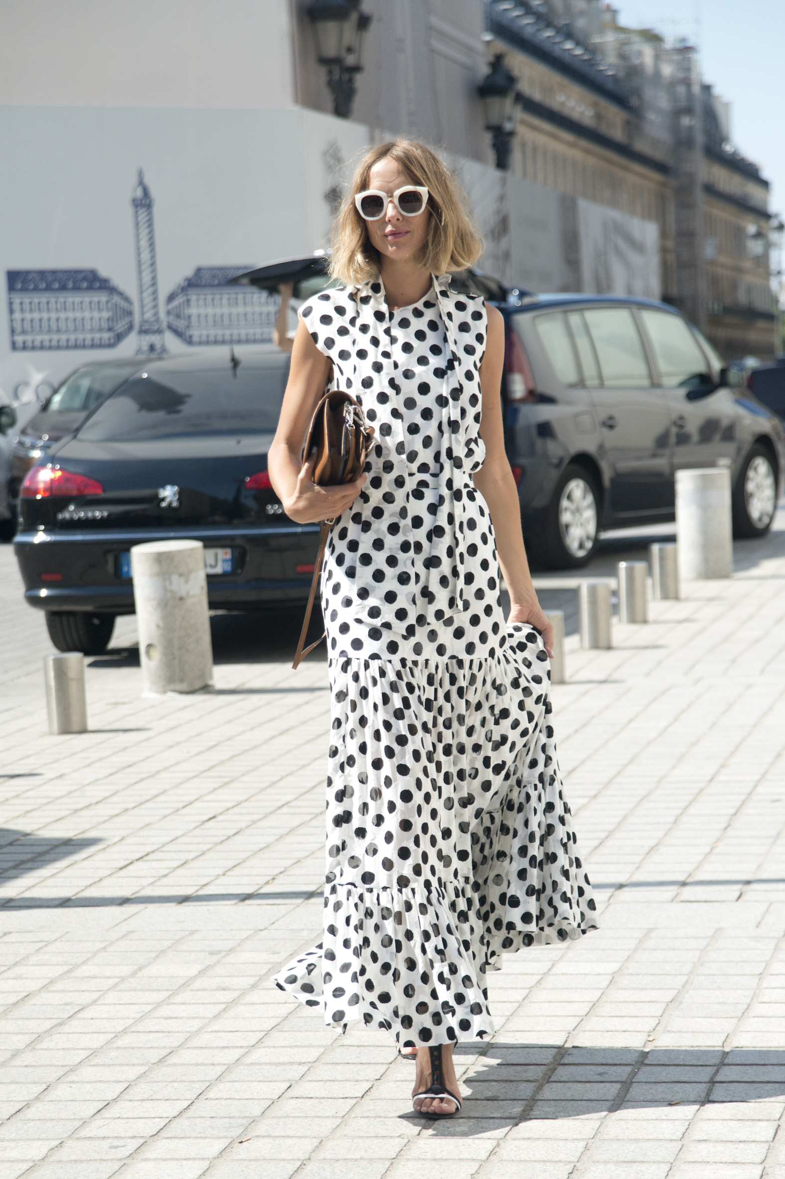 PARIS, FRANCE - JULY 6: Fashion Blogger Candela Novembre wears an Antonio Marras dress, Sergio Rossi shoes, MSGM bag and Spektre sunglasses on day 2 of Paris Fashion Week Haute Couture Autumn/Winter 2015 on July 6, 2015 in Paris, France. (Photo by Kirstin Sinclair/Getty Images)