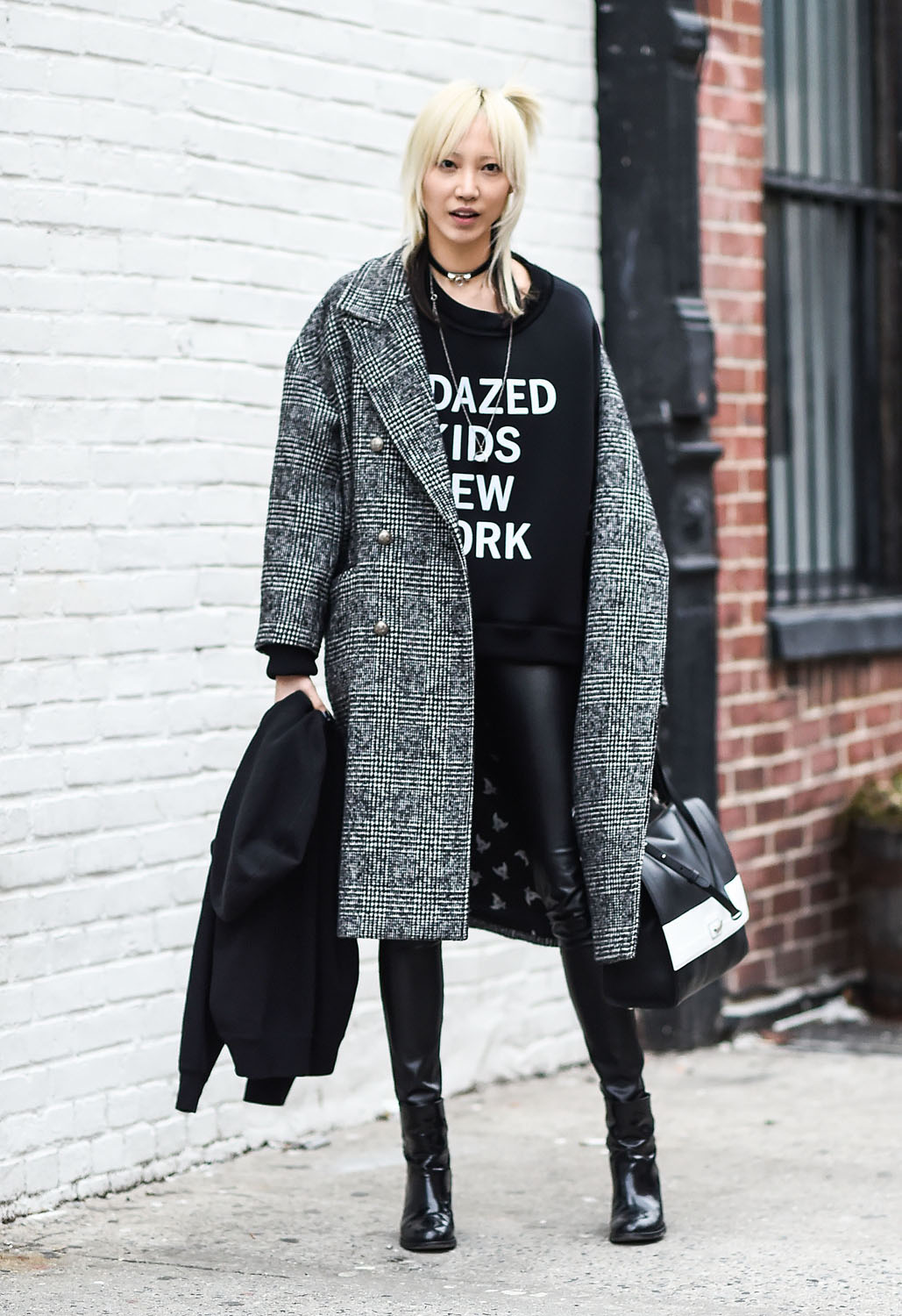 NEW YORK, NY - FEBRUARY 17: Soo Joo Park is seen outside the DKNY show wearing a DKNY sweater during New York Fashion Week: Women's Fall/Winter 2016 on February 17, 2016 in New York City. (Photo by Daniel Zuchnik/Getty Images)