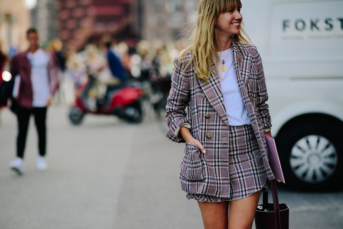 Woman wearing suit with mini skirt