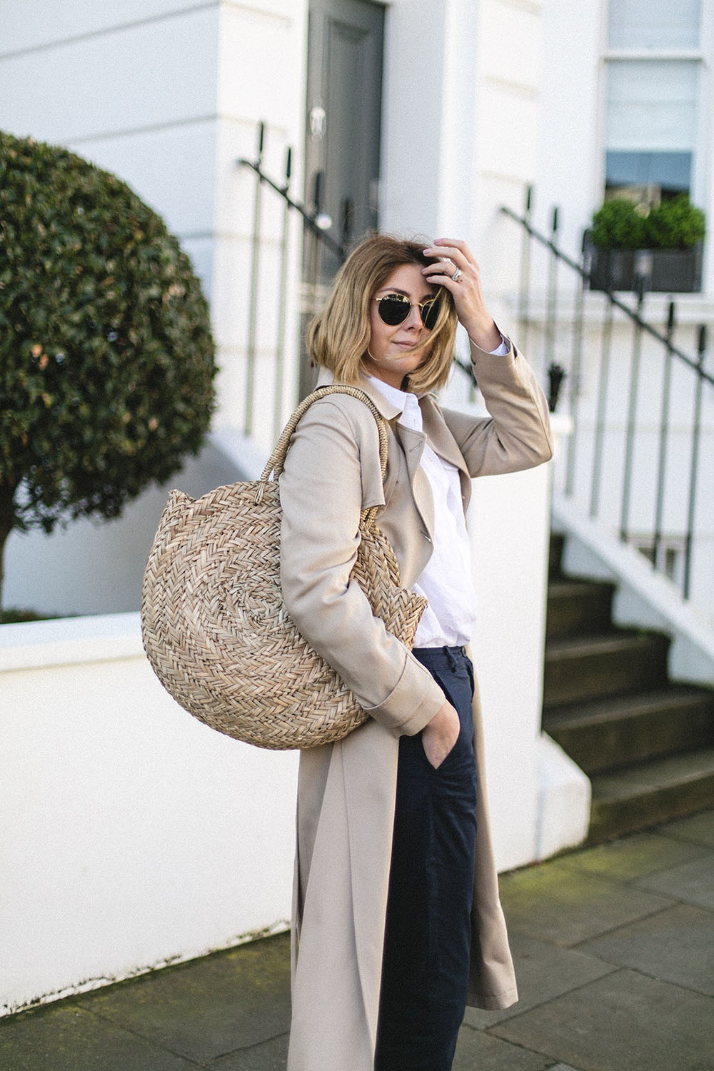 Emma-Hill-style-round-basket-bag-trench-coat-spring-wardrobe-staples-white-linen-shirt-navy-chinos