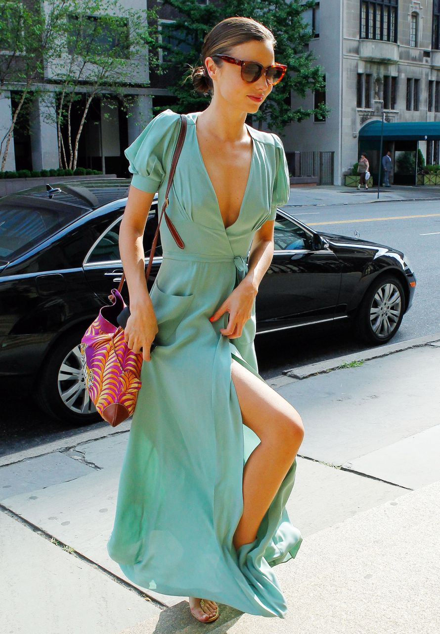 80935, NEW YORK, NEW YORK - Thursday July 12, 2012. Australian supermodel Miranda Kerr seen looking stunning wearing a long silk flowing dress while leaving her apartment in New York. The wife of famous English actor Orlando Bloom topped off her look with a lion print handbag, sandals and sunglasses while making her way to an art building. ***BRAZIL OUT*** Photograph: ©Wagner Az, PacificCoastNews.com **FEE MUST BE AGREED PRIOR TO USAGE** **E-TABLET/IPAD & MOBILE PHONE APP PUBLISHING REQUIRES ADDITIONAL FEES** LOS ANGELES OFFICE:+1 310 822 0419 LONDON OFFICE:+44 20 8090 4079