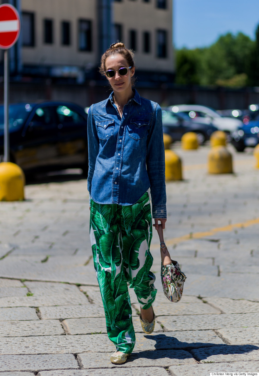MILAN, ITALY - JUNE 20: A guest wearing a denim shirt and wide pants with floral prints outside Gucci during the Milan Men's Fashion Week Spring/Summer 2017 on June 20, 2016 in Milan, Italy. (Photo by Christian Vierig/Getty Images)