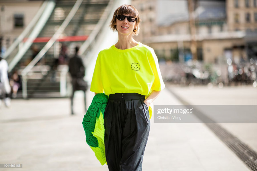 PARIS, FRANCE - OCTOBER 01: Anya Ziourova wearing neon tshirt, black wide leg pants is seen outside Giambattista Valli during Paris Fashion Week Womenswear Spring/Summer 2019 on October 1, 2018 in Paris, France. (Photo by Christian Vierig/Getty Images)