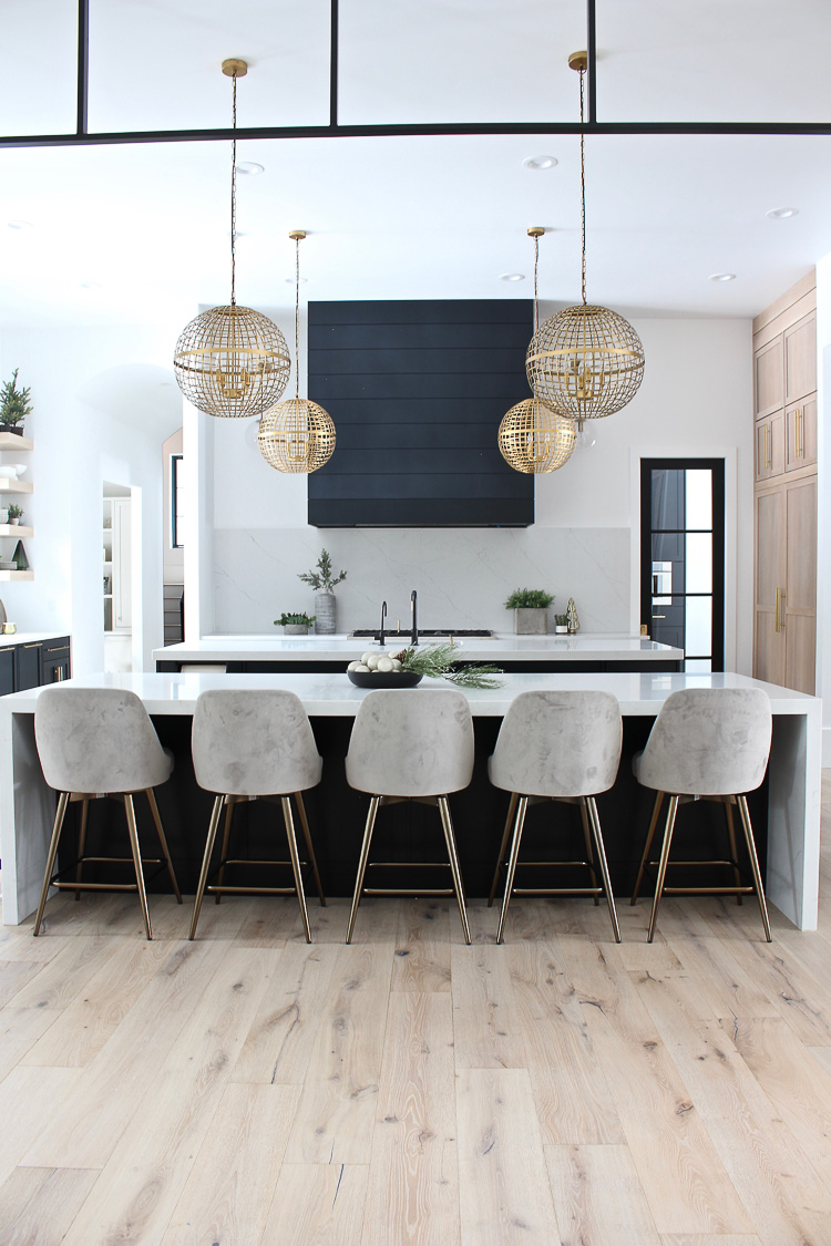 christmas-decorations-modern-kitchen-rift-sawn-white-oak-black-cabinets-black-shiplap-hood-steel-transoms